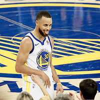 OAKLAND, CA - MAY 31: Stephen Curry #30 of the Golden State Warriors celebrates in Game One of the 2018 NBA Finals won 124-114 in OT by the Golden State Warriors over the Cleveland Cavaliers at the Oracle Arena on May 31, 2018 in Oakland, California. NOTE TO USER: User expressly acknowledges and agrees that, by downloading and or using this photograph, User is consenting to the terms and conditions of the Getty Images License Agreement. Mandatory Copyright Notice: Copyright 2018 NBAE (Photo by Chris Elise/NBAE via Getty Images)