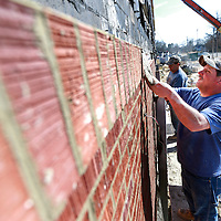 THOMAS WELLS | BUY at PHOTOS.DJOURNAL.COM<br /> Tim Armour of James Masonary continues to lay brick on the new building under construction at Shannon High School on Friday.