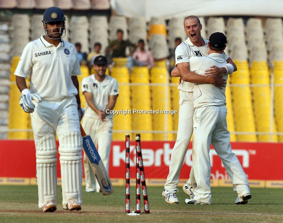 New Zealand Bowler Chris Martin Celebrates With Team Mates After Take Indian Batsman Captain MS Dhoni Wicket During The India vs New Zealand 1st Test Match Played at Sardar Patel Stadium, Motera, Ahmedabad 7, November 2010 (5-day match)