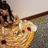 Heather Hamm sits dressed as BelleSunday December 7, 2014 during Aniwave 2014 at the Wilmington Convention Center in Wilmington, N.C. (Jason A. Frizzelle)