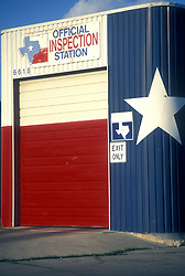 Inspection station auto garage painted like a Texas flag