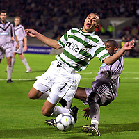 LARSSON FOULED BY SOMMEIL FOR CELTIC,S PENALTY.PIC CHRISTIAN COOKSEY.26/10/00