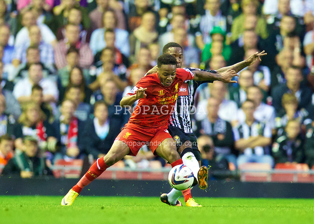LIVERPOOL, ENGLAND - Tuesday, August 27, 2013: Liverpool's Raheem Sterling and Notts County's Jamal Campbell-Ryce during the Football League Cup 2nd Round match at Anfield. (Pic by David Rawcliffe/Propaganda)