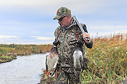 Successful waterfowl hunters with their bag