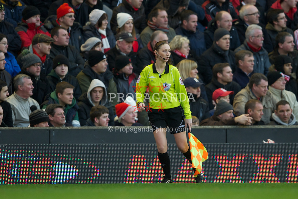 LIVERPOOL, ENGLAND - Saturday, January 14, 2012: Assistant referee Sian Massey runs the line as Liverpool take on Stoke City during the Premiership match at Anfield. (Pic by David Rawcliffe/Propaganda)