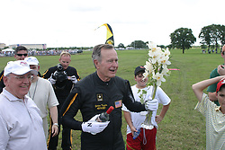 After finishing his parachute jump with the United States Army Golden Knights Parachute Team at the Bush Presidential Library near Houston, Texas on June 13, 2004 to celebrate his his 80th birthday, former President George H.W. Bush is congratulated by former Soviet President Mikhail Gorbachev. Photo by US Army via CNP/ABACAPRESS.COM