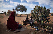 A woman sits with her children in a camp of internally displaced people by the side of the road on the highway outside of Diffa, Niger on February 14, 2016. Caritas undertook a distribution of two blankets per family in January, 2016. Most of the displaced people are from the town of Chilori, Niger on the border with Nigeria and fled when the village was attacked by Boko Haram.