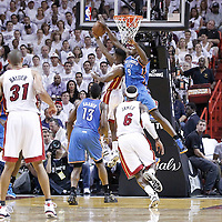 21 June 2012: Miami Heat point guard Norris Cole (30) is blocked by Oklahoma City Thunder power forward Serge Ibaka (9) during the Miami Heat 121-106 victory over the Oklahoma City Thunder, in Game 5 of the 2012 NBA Finals, at the AmericanAirlinesArena, Miami, Florida, USA. The Miami Heat wins the series 4-1.