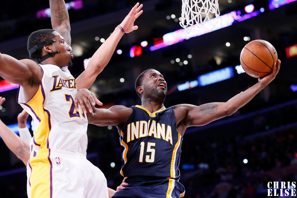 04 January 2014: Indiana Pacers guard Donald Sloan (15) goes for the layup past Los Angeles Lakers guard Jeremy Lin (17) and Los Angeles Lakers forward Ed Davis (21) during the Los Angeles Lakers 88-87 victory over the Indiana Pacers, at the Staples Center, Los Angeles, California, USA.