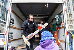 © Licensed to London News Pictures. 31/12/2016. Chicago, USA. A Peace March, organised by Father Michael Pfleger (pictured), takes place down Chicago's Magnificent Mile, Michigan Avenue, to honour the survivors and victims of the city's escalating gun violence.  Marchers carry a 2-foot-tall white wooden cross, each bearing the name of a person killed by gun violence in 2016.  With over 4,300 shootings and more than 750 people killed in 2016, these are the highest totals for 20 years and more than any other large U.S. city in 2016, according to news reports. Photo credit : Stephen Chung/LNP