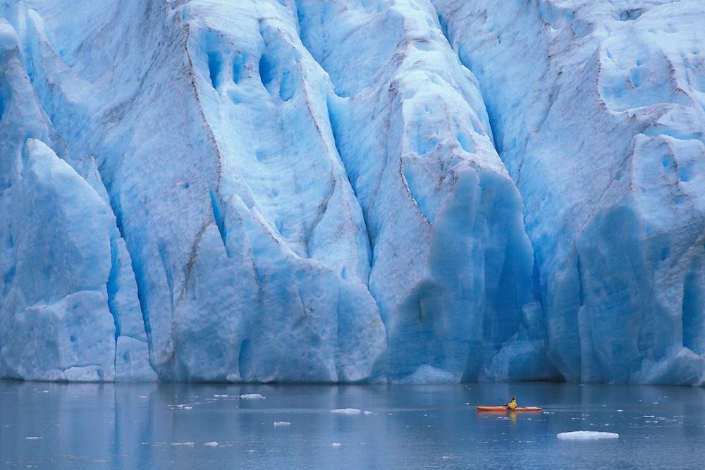Kayaking in front of Bear Glacier, near Stewart, British Columbia, Canada