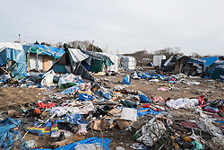 © London News Pictures. Calais, France. 18/01/16.  Abandoned shelters and belongings in the Calais 'Jungle' camp. French authorities are clearing a 100-metre 'buffer zone' between the camp and the adjacent motorway, which leads to the ferry port.   Photo credit: Rob Pinney/LNP