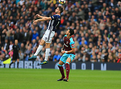 Jay Rodriguez of West Bromwich Albion wins a header as Jose Fonte of West Ham United remains grounded - Mandatory by-line: Paul Roberts/JMP - 16/09/2017 - FOOTBALL - The Hawthorns - West Bromwich, England - West Bromwich Albion v West Ham United - Premier League