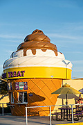 A soft serve ice cream shop, shaped like a giant cone in New Smyrna Beach, Florida.