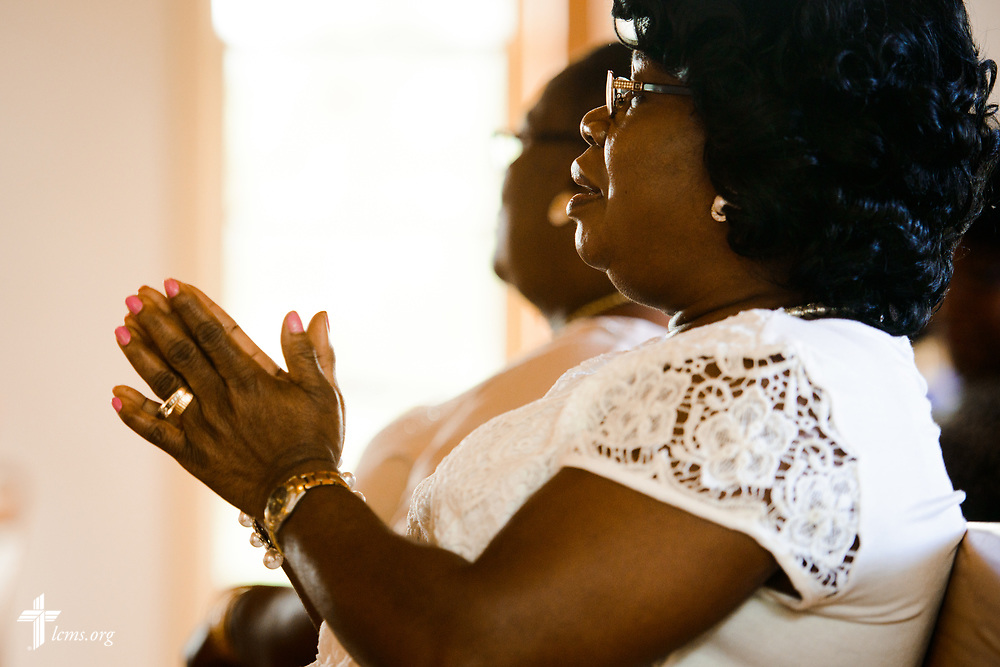 Church members sing during worship at Lamb of God Lutheran Church, housed in Ascension Lutheran Church, Landover Hills, Md, on Sunday, Aug. 7, 2017. LCMS Communications/Erik M. Lunsford