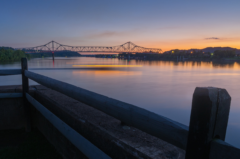 Twilight begins where the Kanawha and Ohio Rivers join from Tu-Endie-Wei park in Point Pleasant as a small sternwheel boat rounds the corner.