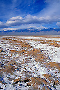 Salt pan under snow-covered Telescope Peak, Death Valley National Park, California