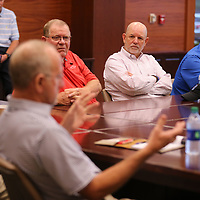 Local mayors listen as Lee County Supervisor Phil Morgan gets the meeting about jail overcrowding underway on Wednesday.
