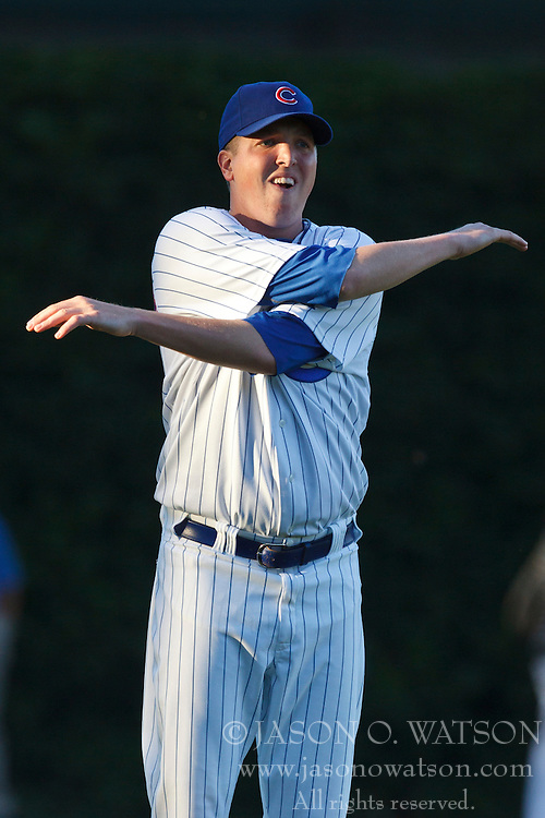 August 16, 2010; Chicago, IL, USA;  Chicago Cubs starting pitcher Tom Gorzelanny (32) warms up in the outfield before the game against the San Diego Padres at Wrigley Field.