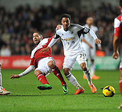 Swansea City's Jonathan de Guzman wins the ball from Fulham's John Arne Riise - Photo mandatory by-line: Alex James/JMP - Tel: Mobile: 07966 386802 28/01/2014 - SPORT - FOOTBALL - Liberty Stadium - Swansea - Swansea City v Fulham - Barclays Premier League