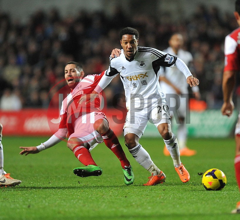 Swansea City's Jonathan de Guzman wins the ball from Fulham's John Arne Riise - Photo mandatory by-line: Alex James/JMP - Tel: Mobile: 07966 386802 28/01/2014 - SPORT - FOOTBALL - Liberty Stadium - Swansea - Swansea City v Fulham - Barclays Premier League