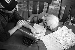 Bryan Hoben helps his daughter Lotus with her Chinese school works while social distancing during the coronavirus pandemic in the Hudson Valley, New York.  Forest and Lotus Hoben, ages 10 and 6, were adopted from China and have albinism, a rare group of genetic disorders that cause the skin, hair, or eyes to have little or no color. Albinism is also associated with vision problems. According to the National Organization for Albinism and Hypopigmentation, about 1 in 18,000 to 20,000 people in the United States have a form of albinism.