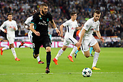 Real Madrid striker Karim Benzema (9) dribbling into Spurs box during the Champions League match between Tottenham Hotspur and Real Madrid at Wembley Stadium, London, England on 1 November 2017. Photo by Matthew Redman.