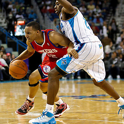 January 3, 2011; New Orleans, LA, USA; Philadelphia 76ers shooting guard Evan Turner (12) drives past New Orleans Hornets small forward Quincy Pondexter (20) during the second quarter at the New Orleans Arena.   Mandatory Credit: Derick E. Hingle