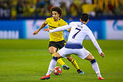 Borussia Dortmund midfielder Axel Witsel (28) goes past Tottenham Hotspur forward Heung-Min Son (7) during the Champions League round of 16, leg 2 of 2 match between Borussia Dortmund and Tottenham Hotspur at Signal Iduna Park, Dortmund, Germany on 5 March 2019.