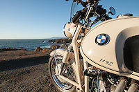 A 1960s BMW R60US motorcycle (PR) parked overlooking the Pacific Ocean in Sonoma County California.