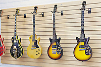 Display of guitars in a guitar store