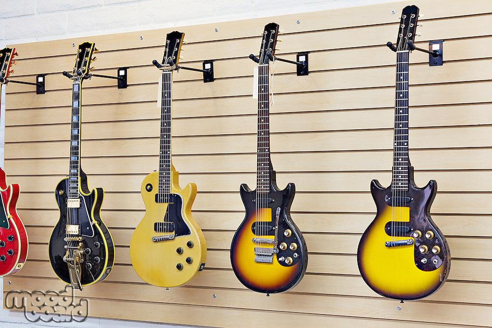 Display of guitars in a guitar store