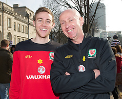 CARDIFF, WALES - Thursday, March 1, 2012: Members of the Football Association of Wales take part in the 10th St. David's Day Parade through the streets of Cardiff.  Head of pubic affairs Ian Gwyn Hughes and his son. (Pic by David Rawcliffe/Propaganda)