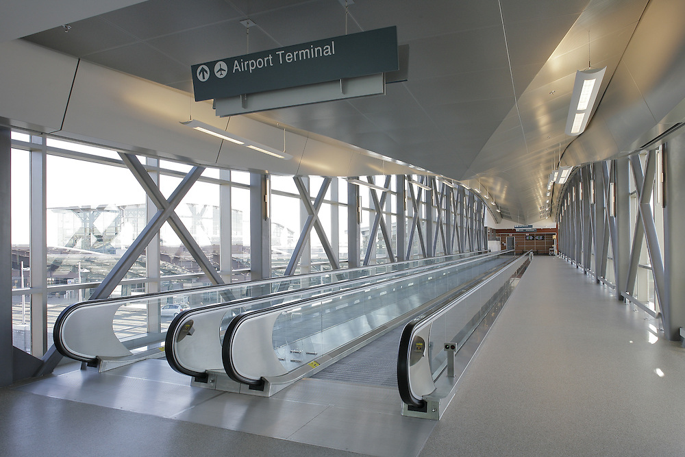 T.F. Green Airport, Interlink Pedestrian Bridge: Tessellations(r) panels from Ceilings Plus can be fabricated in almost any polygonal shapes. These panels are finished with Arboreal(r) real wood veneers and micro-perforated for acoustics.