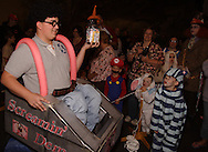 Austin Davis, 14 of Fairborn (left) shows off his first place trophy in round two of the costume contest during Howl-O-Ween 2010 at the Boonshoft Museum of Discovery in Dayton, Saturday, October 23, 2010..