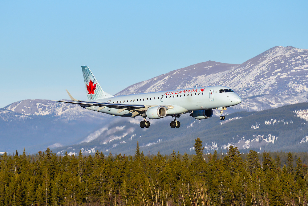 Air Canada Embraer 190 landing with Yukon mountains as a backdrop