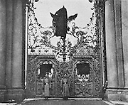 Gates of the former imperial palace at Tsarskoye Selo - during the Russian Revolution red fabric covers the crowns and monograms of imperialism, photograph by Daily Mirror, published in L'Illustration no.3870, 5th May 1917. Picture by Manuel Cohen