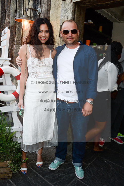 MILES LEONARD and ELIZA DOOLITTLE attending the Warner Bros. & Esquire Summer Party held at Shoreditch House, Ebor Street, London E1 on 18th July 2013.