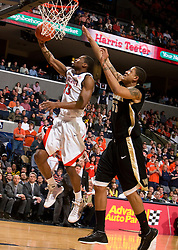 Virginia guard Jeff Jones (23) shoots a layup past Wake Forest center Tony Woods (55).  The Virginia Cavaliers fell to the #13 ranked Wake Forest Demon Deacons 70-60 at the John Paul Jones Arena on the Grounds of the University of Virginia in Charlottesville, VA on February 28, 2009.