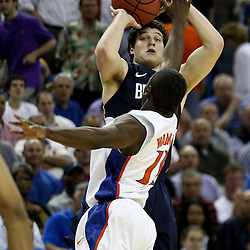 Mar 24, 2011; New Orleans, LA; Brigham Young Cougars guard Jimmer Fredette (32) shoots over Florida Gators guard Kenny Boynton (1) during the first half of the semifinals of the southeast regional of the 2011 NCAA men's basketball tournament at New Orleans Arena.  Mandatory Credit: Derick E. Hingle