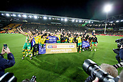 Norwich City players celebrate promotion to the Premier League after the EFL Sky Bet Championship match between Norwich City and Blackburn Rovers at Carrow Road, Norwich, England on 27 April 2019.
