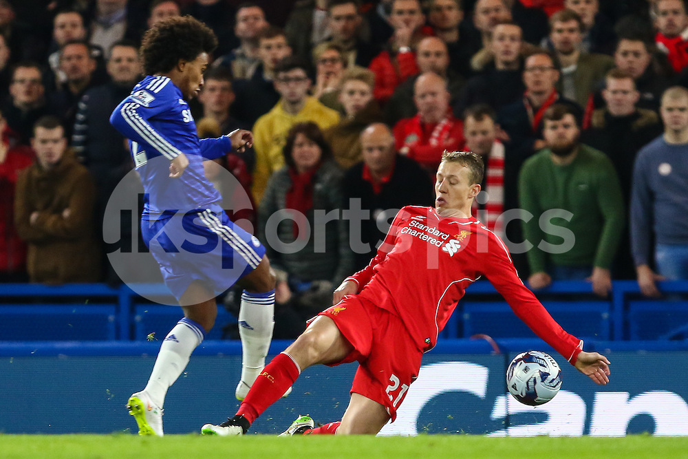 Willian of Chelsea has his appeals for a penatly turned down as it looks like Lucas Leiva of Liverpool handles the ball during the Capital One Cup Semi Final 2nd Leg match between Chelsea and Liverpool at Stamford Bridge, London, England on 27 January 2015. Photo by David Horn.