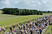 Nederland, Groesbeek, 17-7-2014 4 Daagse, Dag van Groesbeek, Zevenheuvelenweg. De vierdaagse is het grootste wandelevenement ter wereld. Deze dag is beroemd vanwege de heuvels die belopen moeten worden. Ook is er de militaire begraafplaats waar veel canadezen begraven liggen die hier gevochten hebben tijdens de oorlog. De soldaten uit Canada brengen elk jaar een eerbetoon aan deze plek.Blaren en voeten worden verzorgd op een hulppost van Rode Kruis en de landmacht. Ook de plaatselijke bevolking en vooral de jeugd verzorgen veel afleiding met muziek en eten en drinken op het parcours. The International Four Day Marches Nijmegen, Nymegen is the largest marching event in the world. It is organized every year in Nijmegen mid-July as a means of promoting sport and exercise. Participants walk 30, 40 or 50 kilometers daily, and receive a medal, Vierdaagsekruisje. The maximum number of paticipants is 45,000 . Today was the day of Groesbeek, part of operation Market Garden during ww2, ww, two.FOTO: FLIP FRANSSEN/ HOLLANDSE HOOGTE