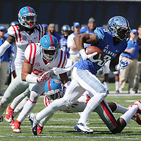Lauren Wood | Buy at photos.djournal.com<br /> Memphis wide receiver Anthony Miller outruns Ole Miss defenders during Saturday's game at Memphis.