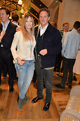 ELLIE SHEPHERD and HARRY BECHER at a party to celebrate the publication of 'Inspire: The Art of Living With Nature' by Willow Crossley held at Anthropologie, 131-141 Kings Road, London on 13th March 2014.