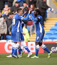 Cardiff City's Kenwyne Jones celebrates with Cardiff City's  - Photo mandatory by-line: Alex James/JMP - Mobile: 07966 386802 - 24/01/2015 - SPORT - Football - Cardiff - Cardiff City Stadium - Cardiff City v Reading - FA Cup Fourth Round