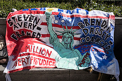 © Licensed to London News Pictures. 02/04/2016. London, UK. A banner hung in front of the US Embassy in London as protesters call for the release of Steven Avery and Brendan Dassey, both jailed in connection with the 2005 murder of Teresa Halbach in Wisconsin, USA. The case was brought to prominence by the hit Netflix series 'Making a Murderer', which suggests the possibility of foul play in the arrest and convictions of the two men. Photo credit : Rob Pinney/LNP