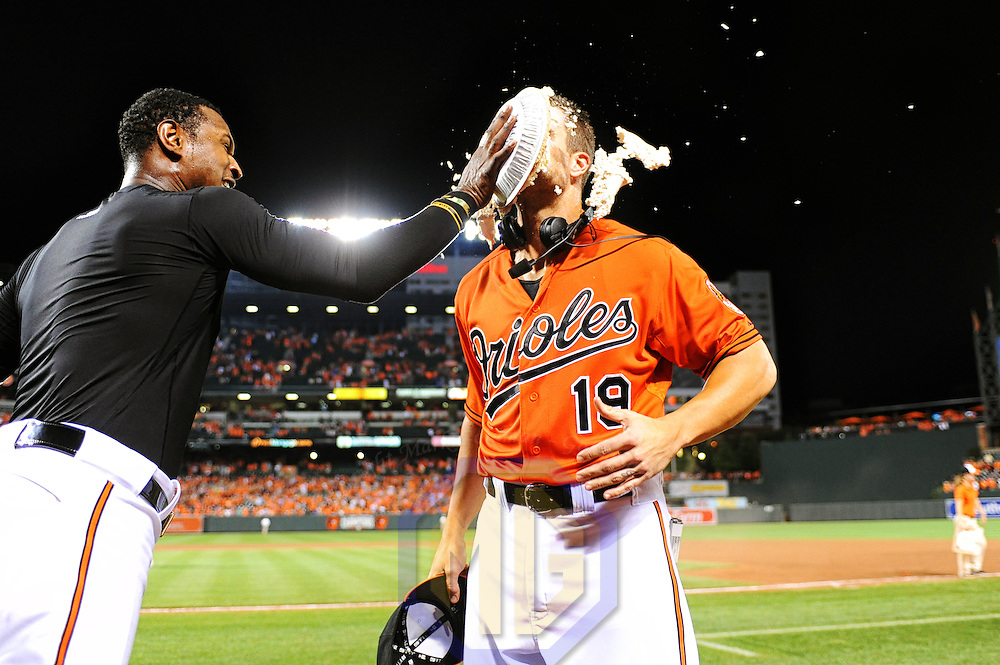 15 August 2015:  Baltimore Orioles center fielder Adam Jones (L) hits first baseman Chris Davis (R) with a pies after his game winning walk off home run against the Oakland Athletics at Orioles Park at Camden Yards in Baltimore, MD. where the Baltimore Orioles defeated the Oakland Athletics, 4-3.  (Photograph by Mark Goldman - Goldminephotos)