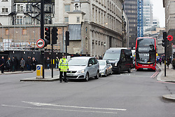© Licensed to London News Pictures. 10/03/2016. London, UK. Police stop traffic as they seal off Bishopsgate near Liverpool Street during a bomb scare this morning. Roads into the area were sealed off and have now reopened. Photo credit : Vickie Flores/LNP