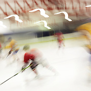 The blurred movement of Ice Hockey players during the Southern Stampede V Canterbury Red Devils National Ice Hockey League matches at the Queenstown Ice Arena, Southern Stampede won both series games 5-3 and 5-2. Queenstown, South Island, New Zealand, 16th July 2011